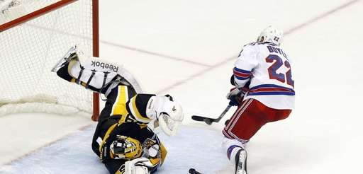 New York Rangers' Dan Boyle gets past a