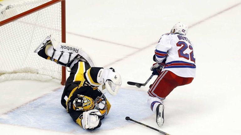 New York Rangers' Dan Boyle gets past a