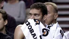 Brooklyn Nets center Brook Lopez watches from the