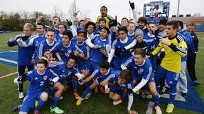 Mattituck players celebrate their championship following the Class