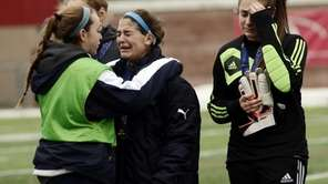 South Side's Victoria Reis, center, is consolled by