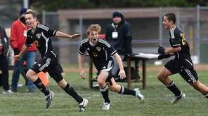 Commack's Anthony Izzo celebrates his first goal with