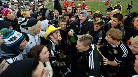 Commack players celebrate their win with their fans