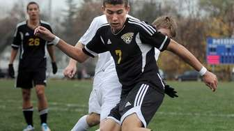 Commack's Justin Ceboller turns to take a shot