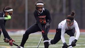 Sachem East's Cara Trombetta, right, pressures Mamaroneck's Elizabeth