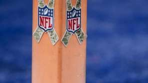 A football sits near the pylon marking the