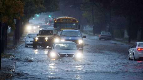 Heavy rains caused Merrick Ave. to flood, forcing