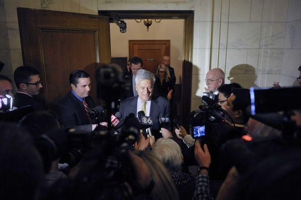 Senate Majority Leader Dean Skelos talks to members