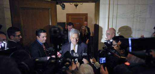 Senate Majority Leader Dean Skelos talks to members