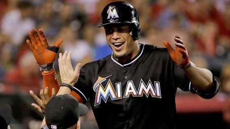 The Miami Marlins' Giancarlo Stanton celebrates his home