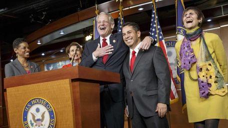 Rep. Steve Israel, D-N.Y., center, jokes that it