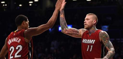 The Miami Heat's Chris Andersen, right, gets a