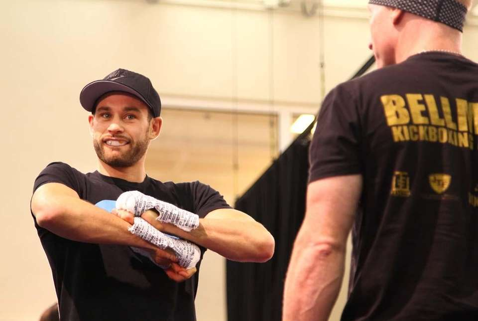 Chris Algieri adjusts his hand wraps as he