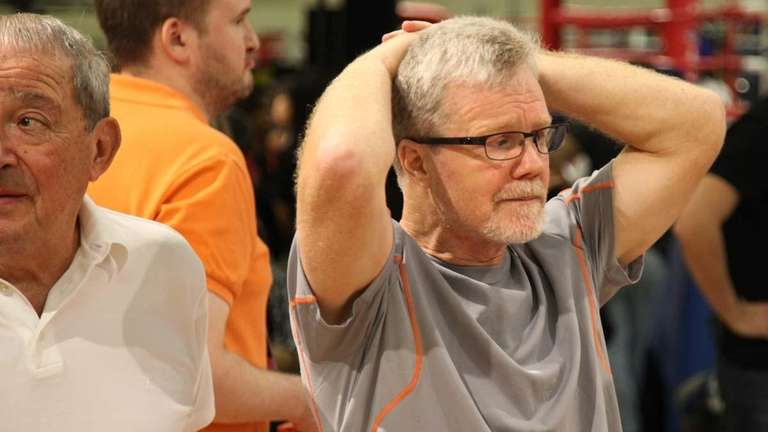 Trainer Freddie Roach, right, waits for his fighter