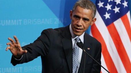 U.S. President Barak Obama gestures as he answers