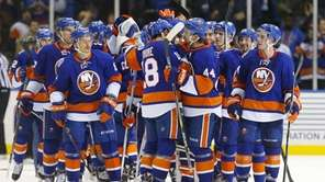 The Islanders celebrate after defeating the Tampa Bay