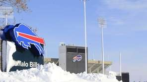 Snow covers a sign at Ralph Wilson Stadium,