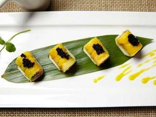 The mango-spicy tuna roll is served with crab