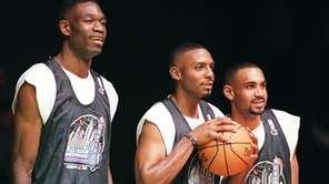 NBA Eastern Conference starters, from left, Dikembe Mutombo