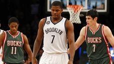 Joe Johnson of the Brooklyn Nets looks on