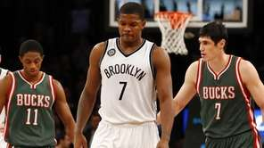 Joe Johnson of the Brooklyn Nets looks on