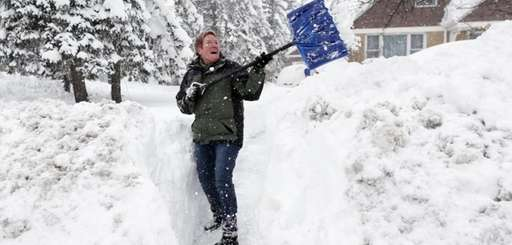 Sue Radka helps shovel out a friends driveway