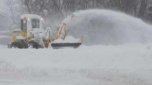 A snowblower clears away snow from an eastbound