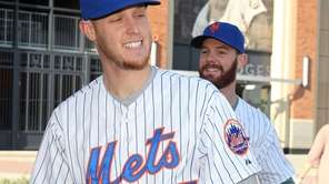 Mets pitchers Zack Wheeler and Vic Black carry