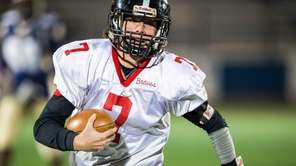 Syosset quarterback William Hogan runs for a first
