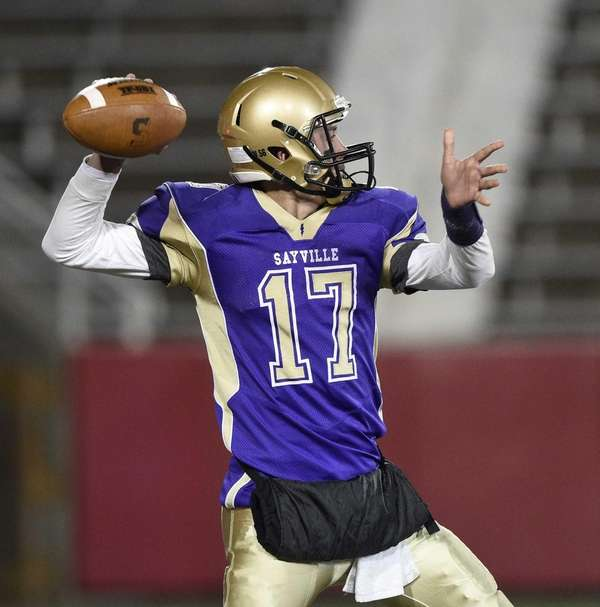 Sayville quarterback Jack Coan throws a 97-yard touchdown