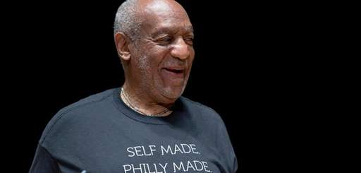 Entertainer and former classmate Bill Cosby speaks during