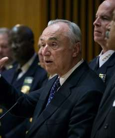 Police Commissioner William J. Bratton speaks Friday, Nov.