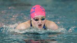 St. Anthony's Beth Caruana swims in a preliminary