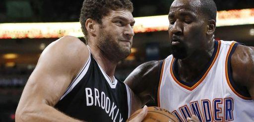 Brooklyn Nets' Brook Lopez, left, drives past Oklahoma