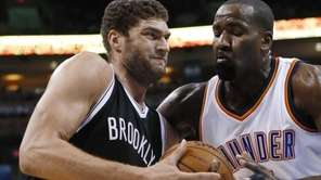 Brooklyn Nets' Brook Lopez, left, drives past Oklahoma