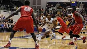 Hofstra Pride guard Dion Nesmith drives to the