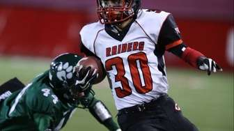 Patchogue-Medford running back Dominick Cassella runs the ball