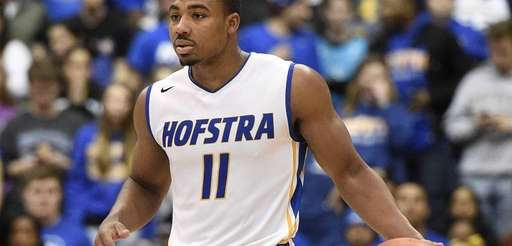 Hofstra Pride guard Dion Nesmith controls the ball