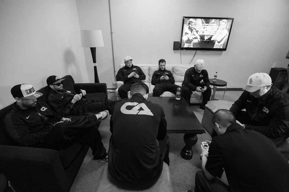 Team Algieri spends a moment before weigh-ins on