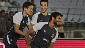 Spanish soccer star Luis Garcia, center, trains with