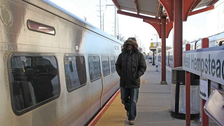 A commuter arrives at the West Hempstead branch