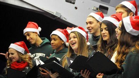 A Holy Trinity High School choir sings at