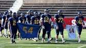 Shoreham-Wading River High School football players carry a