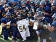 Shoreham-Wading River High School football players hold up