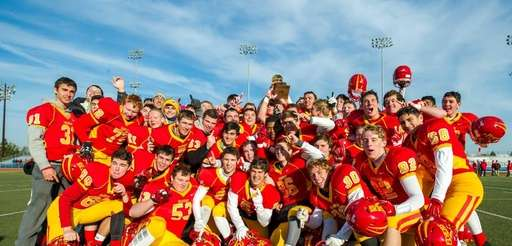 Chaminade poses for a photo after winning the