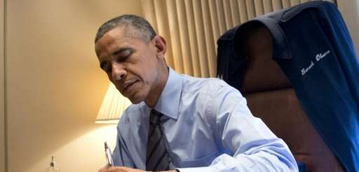 President Barack Obama signs two presidential memoranda associated