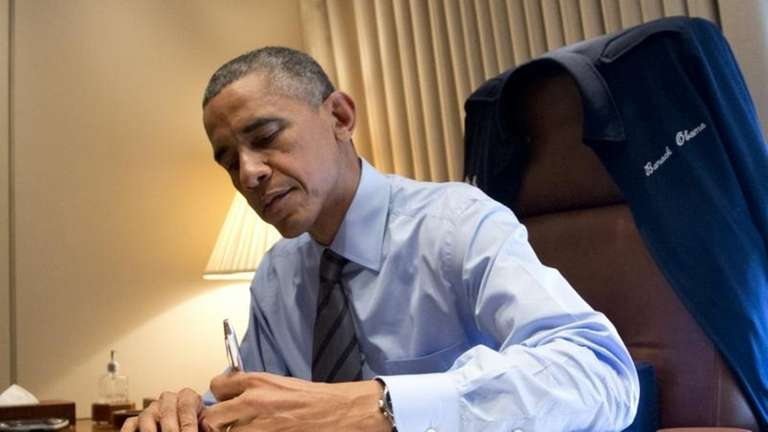 President Barack Obama signs two presidential memoranda associated