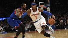 New York Knicks forward Carmelo Anthony drives the