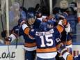 Islanders teammates surround Islanders left wing Matt Martin