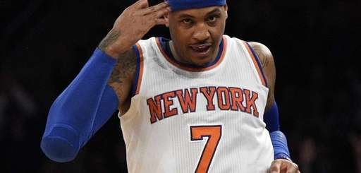 Knicks forward Carmelo Anthony reacts after sinking a